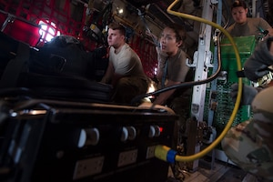 From left, Senior Airman Robert McCabe, 379th Expeditionary Aeromedical Evacuation Squadron (EAES) aeromedical evacuation technician, and Capt. Aline Putnam, 379th EAES flight nurse, fasten a litter and medical equipment into place on a C-130 Hercules at Al Udeid Air Base, Qatar, before a recent aeromedical evacuation mission.