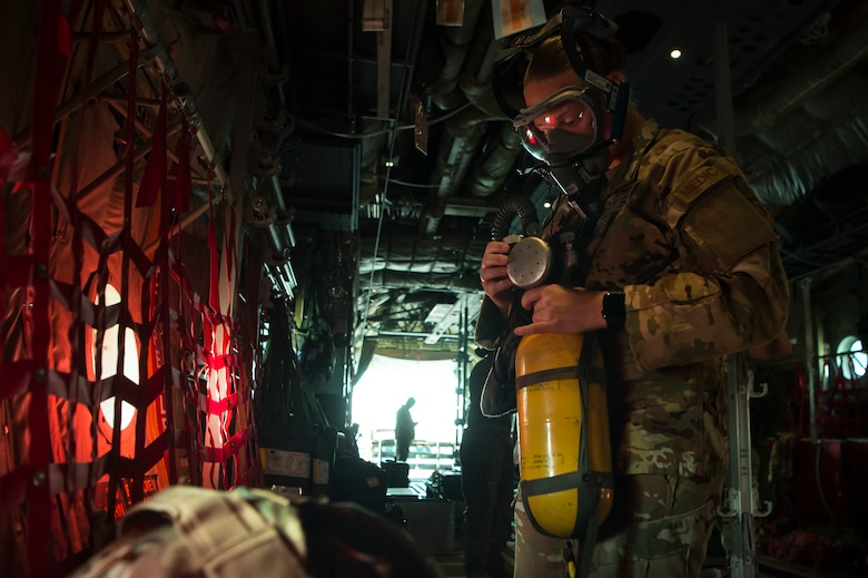 Staff Sgt. Lyndsey Glotfelty, 379th Expeditionary Aeromedical Evacuation Squadron (EAES) aeromedical evacuation technician, ensures medical equipment is operational on a C-130 Hercules at Al Udeid Air Base, Qatar, prior to a recent mission.