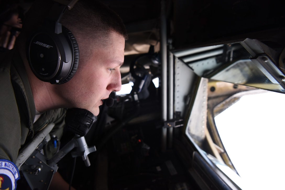 U.S. Air Force Senior Airman Corey Marion, 351st Air Refueling Squadron boom operator, performs air refueling training with Romanian air force F-16s over the skies of Romania, March 11, 2019. The training was an example of U.S. and NATO allies sharing a commitment to promote peace and stability through developing their relationship and communication process. (U.S. Air Force photo by Airman 1st Class Brandon Esau)
