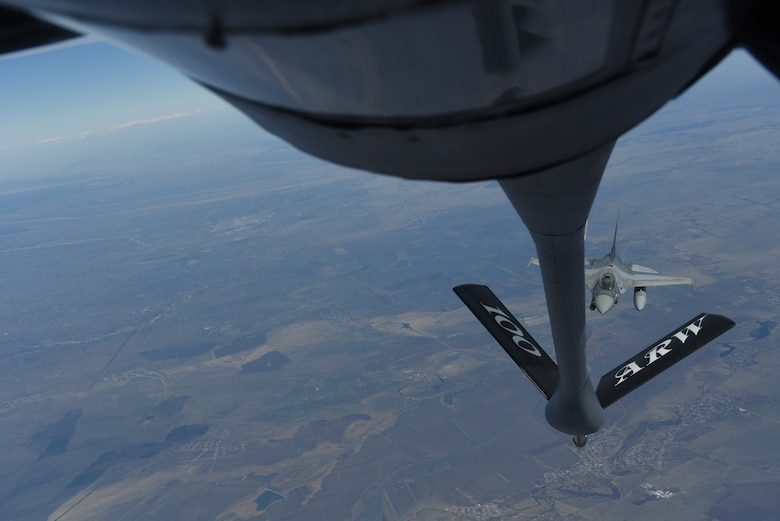 A Romanian air force F-16 prepares to receive fuel from a KC-135 Stratotanker from RAF Mildenhall, England during training over the skies of Romania, March 11, 2019. The training was an example of U.S. and NATO allies sharing a commitment to promote peace and stability through developing their relationship and communication process. (U.S. Air Force photo by Airman 1st Class Brandon Esau)