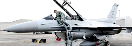 113th Wing pilot Capt. Matthew Morris prepares for an F-16C training flight at Naval Air Station Joint Reserve Base New Orleans. The D.C. Air National Guard Airmen are participating in a two-week flying exercise titled Sentry Voodoo in New Orleans.