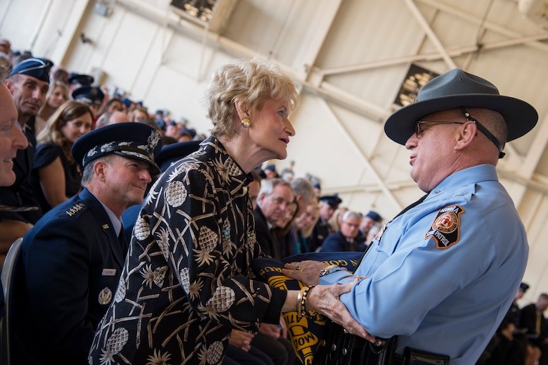 Georgia State Patrol Col. Mark McDonough, Department of Public Safety commissioner, presents a Georgia State flag to Dr. Lucy Greene during the Celebration of Life ceremony honoring the late Mr. W. Parker Greene, March 14, 2019, at Moody Air Force Base, Ga. Greene, a steadfast Air Force advocate and one of the most influential military civic leaders passed away Dec. 18, 2018. (U.S. Air Force Photo by Andrea Jenkins)