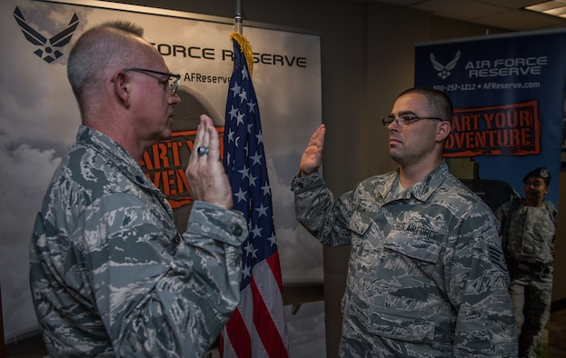 Staff. Sgt. Donovan Klein, new addition to the Air Force Reserve Recruiting services, recites the oath of enlistment given to him on Mar. 13, 2019 by Lt. Col. Stan Paregien, 932nd Airlift Wing Public Affairs Officer, during a reenlistment ceremony at the 932nd AW Headquarters building, Scott Air Force Base, Illinois. Klein, a departing 932nd citizen Airman will start his new Air Force adventure in Wichita, Kansas, helping new citizen Airmen near McConnell AFB begin their own Air Force adventures.  (U.S. Air Force photo by Christopher Parr)