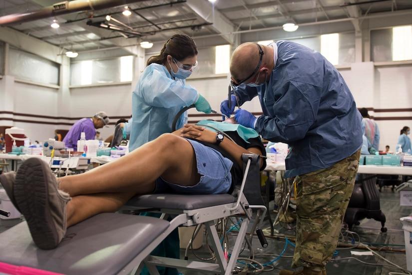 Dentist works on patient