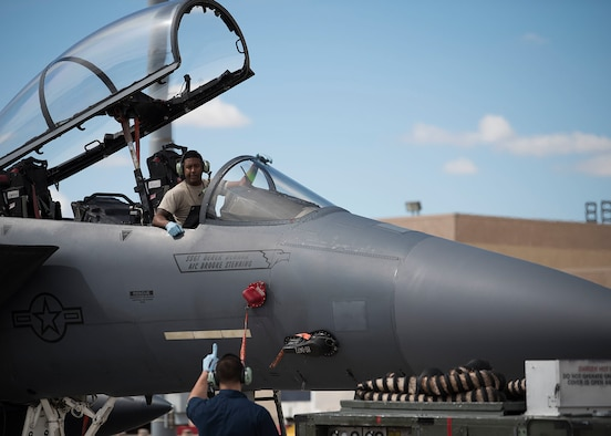 Two U.S. Air Force Airmen assigned to the 4th Aircraft Maintenance Squadron prepare an F-15E Strike Eagle fighter jet that is participating in Red Flag 19-2 at Nellis Air Force Base, Nev., March 12, 2019. Aircraft from Seymour Johnson Air Force Base, N.C., are participating as the Strike role in Red Flag 19-2. (U.S. Air Force photo by Airman 1st Class Bryan Guthrie)