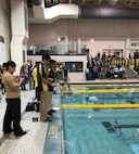 Middle and high school students compete underwater robots in obstacle and task-related courses during the 7th Annual NJ Regional SeaPerch competition, co-hosted by NAWCAD Lakehurst, at Rowan University in Glassboro, New Jersey March 9. (U.S. Navy photo)
