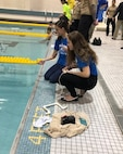 Students learn teamwork skills by working together to design and build an underwater robot as part of the 7th Annual NJ Regional SeaPerch competition at Rowan University in Glassboro, New Jersey March 9. (U.S. Navy photo)