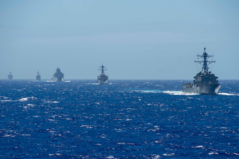 Five military ships operate together in the Philippine Sea.