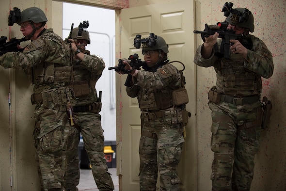 The response force tactical course cadre give a demonstration, to Air Force Global Strike Command defenders during a response force tactical course, on how to properly infiltrate a building during an active shooter scenario Mar. 27, 2019, at the 90th Ground Combat Training Squadron, Camp Guernsey, Wyo. During the training, the Airmen went over various tactics on entering and clearing a room, brushed up on M4 and M9 shooting and went through simulated night time situations with night vision goggles. (U.S. Air Force photo by Senior Airman Abbigayle Williams)