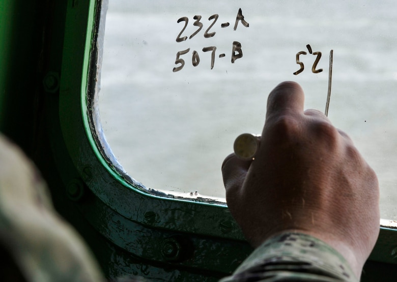 Master-at-Arms Chief Petty Officer Mark Puckett, Coastal Riverine Squadron 10 Bravo 2nd Platoon, takes note of boat movements during battle drills March 12, 2019, at Joint Base Charleston, S.C. – Naval Weapons Station.