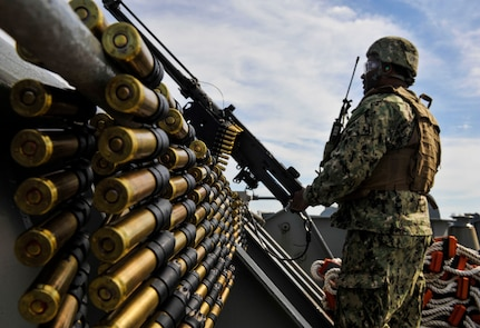 Yeoman 2nd Class Gerard Mercadel, Coastal Riverine Squadron 10 Bravo 2nd Platoon, prepares to fire a 50 caliber machine gun outfitted with blank fire adapters March 14, 2019, at Joint Base Charleston, S.C. – Naval Weapons Station.