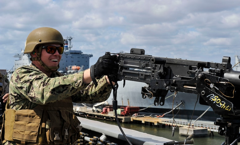 Master-at-Arms Petty Officer 3rd Class Adam Bolas, Coastal Riverine Squadron 10 Bravo 2nd Platoon, fires a 50 caliber machine gun outfitted with blank fire adapters March 14, 2019, at Joint Base Charleston, S.C. – Naval Weapons Station.