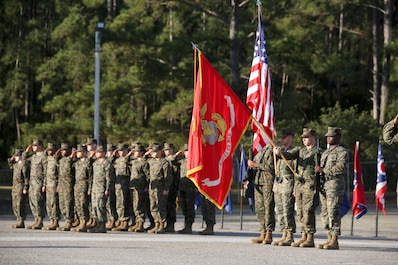Marines stand in formation during Combat Logistic Company 23's realignment ceremony aboard Marine Corps Air Station Beaufort, March 15. During the ceremony, CLC-23 realigned from under the command of Combat Logistics Regiment 25 to 2nd Maintenance Battalion, both aboard Camp Lejeune, N.C.
