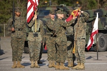 Capt. Kevin Buonomo and 1st Sgt. Adrian Munoz handle the company guidon during Combat Logistics Company 23's realignment ceremony aboard Marine Corps Air Station Beaufort, March 15. Buonomo is the Company Commander and Munoz is the Company 1st Sgt. of CLC-23.