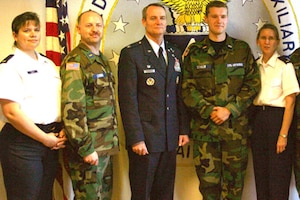 Teresa Conner, now headquarters Civil Air Patrol Montana wing administrator, left, and husband John Conner, now 341st Logistics Readiness Squadron assistant director of logistics and a retired Air Force veteran, second from left, pose for a photo during a Civil Air Patrol event in 2011.