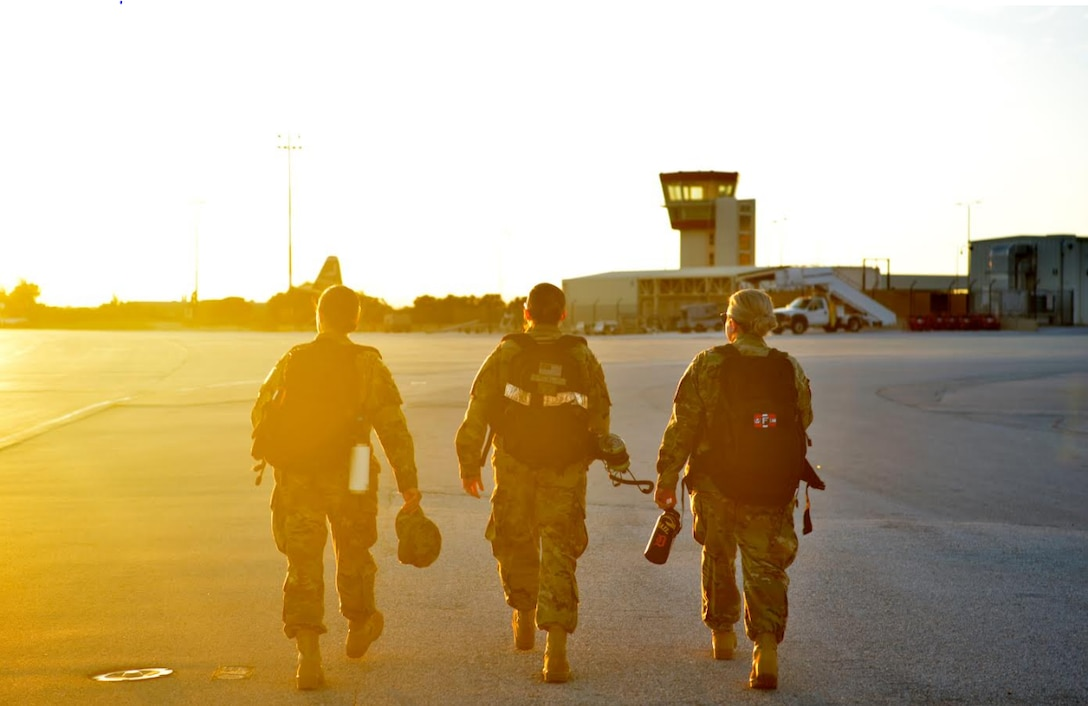 U.S. Air Force Tech. Sgt. Lindsay Hallford, 86th Maintenance Squadron aerospace propulsion C-130J engine mechanic, right, walks alongside U.S. Air Force Senior Airman Nicole Merriss, 86th Maintenance Squadron aerospace propulsion craftsman, left, and U.S. Air Force Airman First Class Ariel Houser, 86th Maintenance Squadron aerospace propulsion apprentice, middle, on the flight line at Crete Naval Base, Greece, March 8, 2019. The team completed a propeller swap on a C-130J Super Hercules Aircraft.