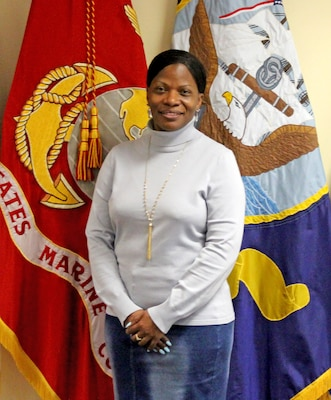 Gina Breleur, a Troop Support Europe and Africa employee was selected Woman of the Year in the non-supervisory GS-9 and below category during the Women's History Month Program March 13.  Breleur was recognized for her exemplary model of public service and government leadership.