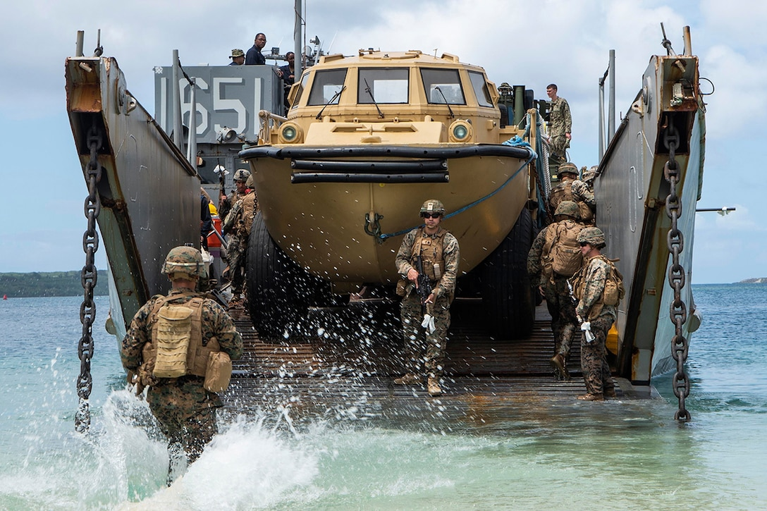 Marines get on a landing craft.