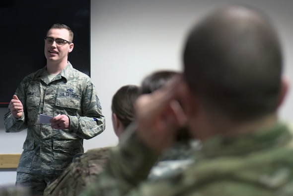 U.S. Air Force Tech. Sgt. Anthony Sweat, 100th Maintenance Squadron NCO-in-charge of non-destructive inspections, gives a presentation about Operation GRIT at RAF Mildenhall, England, March 14, 2019. Operation GRIT is a U.S. Air Forces and Europe-Air Forces Africa program that began in Fall 2018. (U.S. Air Force photo by Senior Airman Benjamin Cooper)