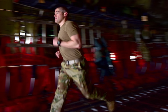 An Airman runs on board a C-130J.
