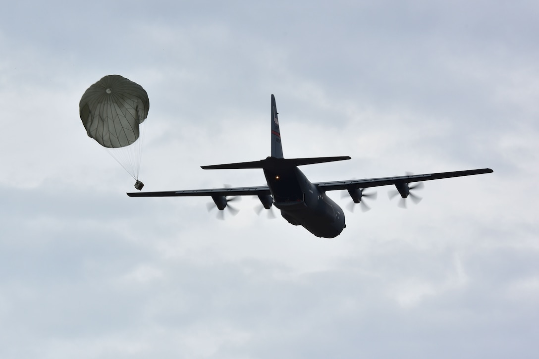 A C-130J does an airdrop.