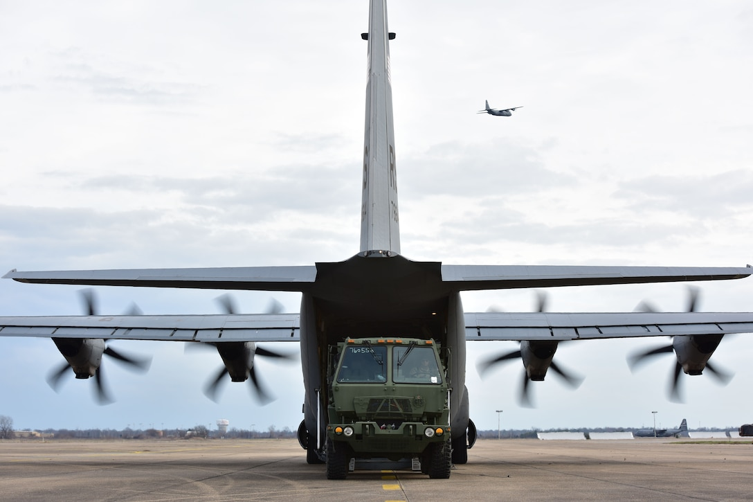 A vehicle gets onloaded to a C-130J.