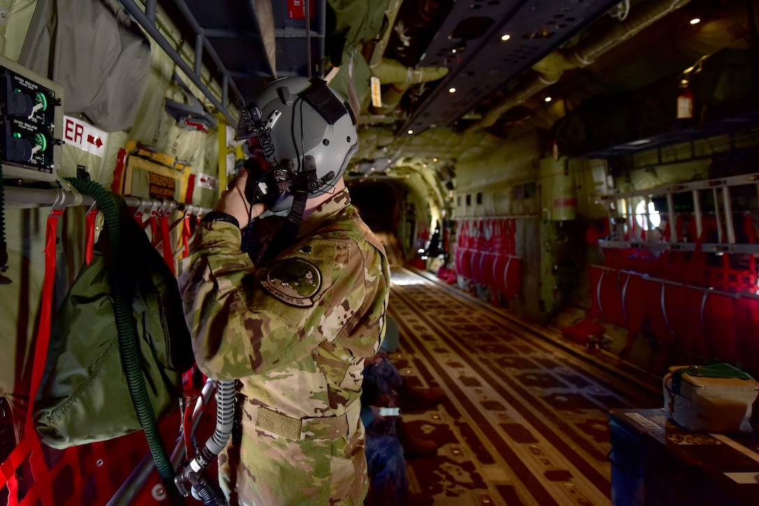An Airman puts on his flight helmet.