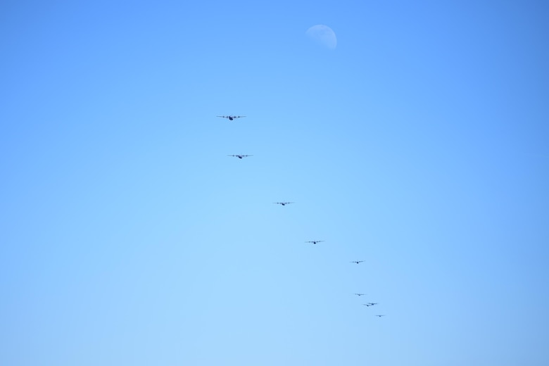 Many C-130Js fly in formation.
