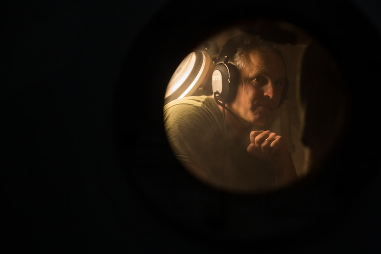 Senior Chief Mark Sawyer, a master diver with 3rd Reconnaissance Battalion, III Marine Expeditionary Force, monitors Marines from inside a Standard Navy Double Lock Hyperbaric Recompression Chamber at Camp Schwab, Okinawa, Japan, Jan. 9, 2019. Sawyer observed the Marines to ensure their safety while in a SNDLRCS during a training scenario to simulate the pressure felt when diving up to 60 feet in order to enhance combat readiness.