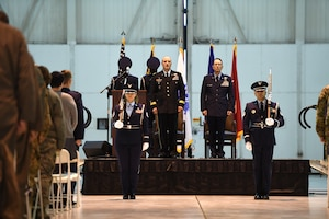 U.S. Army Maj. Gen. Gregory A. Lusk (left), the Adjutant General of North Carolina National Guard Bureau (NCNGB), and U.S. Air Force Col. Stephen J. Mallette (right), director of cyberspace operations for Joint Force Headquarters, NCNGB, stand at attention as members of 145th Force Support Squadron Honor Guard present the colors during Col. Mallette's promotion ceremony at the North Carolina Air National Guard Base, Charlotte Douglas International Airport, Mar. 09, 2019. Family, friends, and guard members gather to watch Col. Mallette pin on the rank of Brig. Gen. He has has served for 37 years including enlisted time in the Army and Air Force.