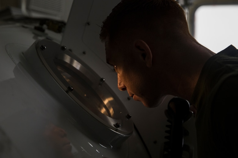 Petty Officer 1st Class Will Crampton, a first class navy diver with 3rd Reconnaissance Battalion, III Marine Expeditionary Force, monitors Marines inside a Standard Navy Double Lock Hyperbaric Recompression Chamber at Camp Schwab, Okinawa, Japan, Jan. 9, 2019. Crampton observed the Marines to ensure their safety while in a SNDLRCS during a training scenario to simulate the pressure felt when diving up to 60 feet in order to enhance combat readiness.