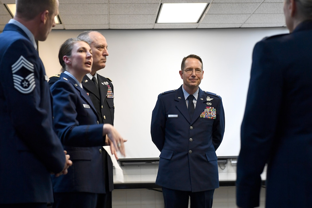 U.S. Air Force Col. Stephen J. Mallette (center), director of cyberspace operations for Joint Force Headquarters, North Carolina (NC) National Guard Bureau, visits with friends and readies himself prior to the start of his promotion ceremony at the NC Air National Guard Base, Charlotte Douglas International Airport, Mar. 09, 2019. Family, friends, and guard members gather to watch Col. Mallette pin on the rank of Brig. Gen. He has has served for 37 years including enlisted time in the Army and Air Force.