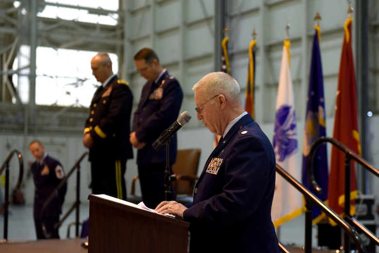 U.S. Air Force Chaplain, Lt. Col. Jeffrey Kidd, gives an opening prayer during the promotion of Col. Stephen J. Mallette, director of cyberspace operations for Joint Force Headquarters, North Carolina (NC) National Guard Bureau, at the NC Air National Guard Base, Charlotte Douglas International Airport, Mar. 09, 2019. Family, friends, and guard members gather to watch Col. Mallette pin on the rank of Brig. Gen. He has has served for 37 years including enlisted time in the Army and Air Force.