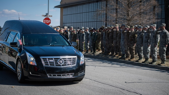 U.S. Air Force citizen Airmen and civilians from the 932nd Airlift Wing stand with Team Scott Mar. 18, 2019, Scott Air Force Base, Illinois, to show respect for the Dignified Transfer of Army Sgt. Holli R. Bolinski, of Pinckneyville, Illinois.  She was killed, along with another soldier in her unit, Spc. Jackson Johnson, of Hillsboro, Missouri, in a non-combat vehicle crash on Mar. 5, 2019, while serving during Operation Inherent Resolve. Bolinski and Johnson were both assigned to the Army Reserve unit 635th Transportation Company, 419th Transportation Battalion, 103rd Sustainment Command, Mount Vernon, Illinois. (U.S. Air Force photo by Christopher Parr)