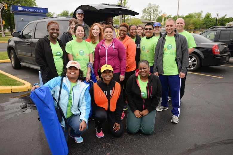 Chief Master Sgt. Takesha Williams, 507th Air Refueling Wing budget analyst, 931st ARW command chief and Reserve course marshal for the Oklahoma City Memorial Marathon, kneels in an orange vest for a photograph with other course marshal volunteers April 26, 2015, in Oklahoma City, Oklahoma. For more than a decade, Williams has been responsible for gathering Reserve volunteers to help manage the course during the marathon. (U.S. Air Force courtesy photo)