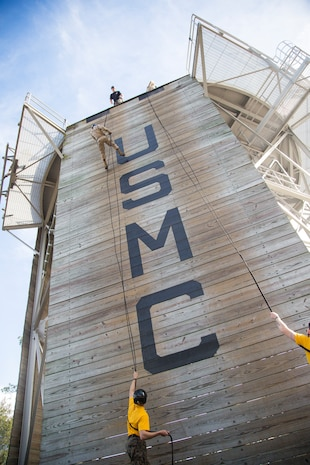 Recruits with Fox Company, 2nd Recruit Training Battalion, rappel down the rappel tower aboard Marine Corps Depot Parris Island,  Feb. 4. The rappel tower is a training event designed to instill confidence within recruits and introduce them to environments they may encounter while serving in the Marine Corps. (U.S. Marine Corps photo by Lance Cpl.Yamil Casarreal)