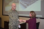 Distribution's Pulgar presented commander's coin