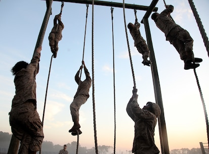Recruits with November Company, 4th Recruit Training Battalion, complete obstacles during the Crucible at Marine Corps Recruit Depot Parris Island, Feb, 21. The Crucible is a 54-hour culminating event that requires recruits to work as a team and overcome challenges in order to earn the title United States Marine. (U.S. Marine Corps photo by Warrant Officer Bobby J. Yarbrough/Released)