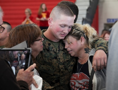 Pfc. Nicholes Kelley is reunited with his family during Family Day at Marine Corps Recruit Depot Parris Island, Feb. 28. Family Day is the day before graduation and is the first time families have seen their Marine since they left home for recruit training. (U.S. Marine Corps photos by Warrant Officer Bobby J. Yarbrough/Released)