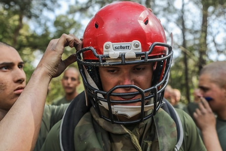 Recruit Joseph Dickman with India Company, 3rd Recruit Training Battalion, engages in body sparring and pugil sticks during the crucible at Marine Corps Recruit Depot Parris Island, S.C., Mar. 15, 2019. Body sparring and pugil sticks help recruits apply the fundamentals of Marine Corps martial arts. (U.S. Marine Corps Photo by Lance Cpl. Shane T. Manson)