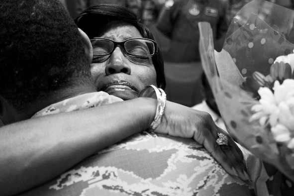 Janice Roberts hugs her son, Master Sgt. Stephen Roberts, after his promotion ceremony.