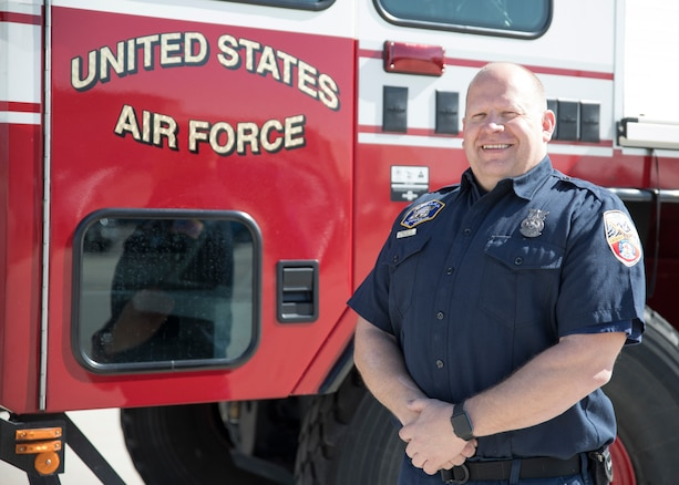 "Firefighter Russell Pressley, a driver/operator with the Roland R. Wright Fire Department stands beside a Oshkosk ""Striker"" Fire Fighting truck March 11, 2019 at Roland R. Wright Air National Guard Base, Salt Lake City, Utah. Pressley responded to a tanker truck fire in Salt Lake City on February 22, 2019 and was able to assist local fire fighters with the specialized truck"