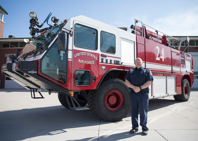 "Firefighter Russell Pressley, a driver/operator with the Roland R. Wright Fire Department stands beside a Oshkosk ""Striker"" Fire Fighting truck March 11, 2019 at Roland R. Wright Air National Guard Base, Salt Lake City, Utah. Pressley responded to a tanker truck fire in Salt Lake City on February 22, 2019 and was able to assist local fire fighters with the specialized truck."