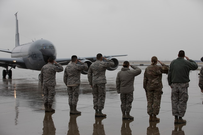"Members of the 151st Operations Group salute as Joint Force Headquarters Assistant Director of Operations, Utah Air National Guard Col. Ryan Ogan taxis in from his ""fini"" flight aboard a KC-135R at Roland R. Wright Air National Guard Base, Salt Lake City, Utah, January 17, 2019. The ""fini"" flight is a time-honored military tradition marking the last flight of an aircrew member's time with a unit or retirement. Prior to being assistant director of operations, Ogan served as the 151st Air Refueling Wing commander."