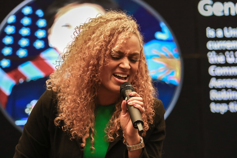 Jennifer Edwards, U.S. Army Central, sings the National Anthem during the Women's History Month observance ceremony at USARCENT headquarters on Shaw Air Force Base, S.C., March 13, 2019.