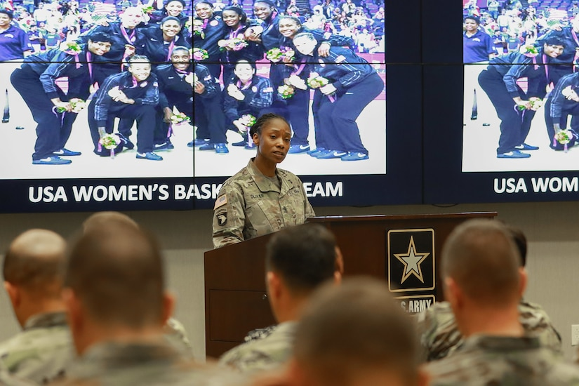 1st Sgt. Teneka S. Oliver, senior enlisted advisor for Intelligence and Sustainment Company, Headquarters and Headquarters Battalion, U.S. Army Central, introduces the guest speaker at the Women's History Month observance ceremony at USARCENT headquarters on Shaw Air Force Base, S.C., March 13, 2019.