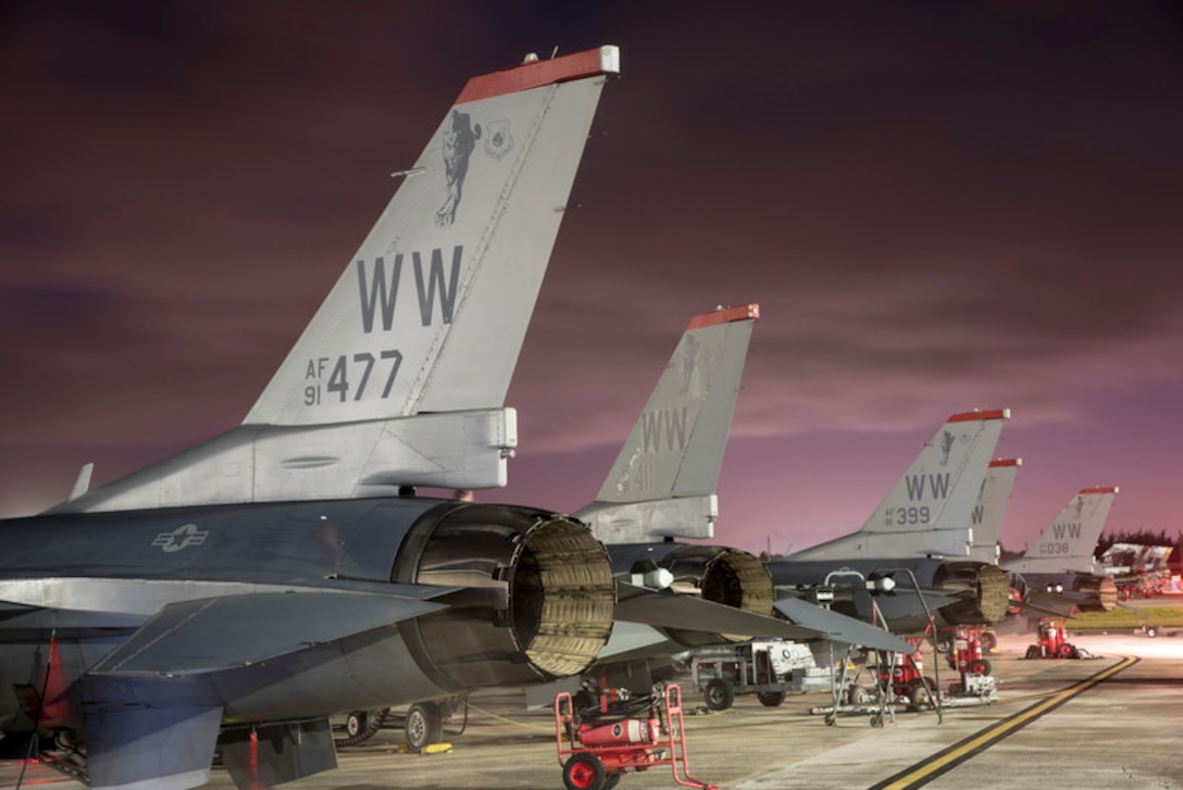 F-16C Fighting Falcons with the 13th Fighter Squadron, assigned to Misawa Air Base, Japan, sit on the south ramp at Andersen Air Force Base, Guam, Feb. 28, 2019. Misawa AB's F-16s were among the nearly 100 aircraft participating in this year's COPE North exercise in Guam. (U.S. Air Force photo by Senior Airman Jarrod Vickers)