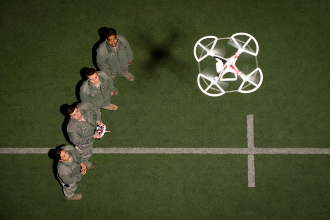 U.S. Air Force Academy cadets in the Unmanned Aerial System Operations Program familiarize themselves with quad-copter flight controls at the Cadet Field House, U.S. Air Force Academy, Colo., March 4, 2019. (U.S. Air Force photo by Joshua Armstrong)
