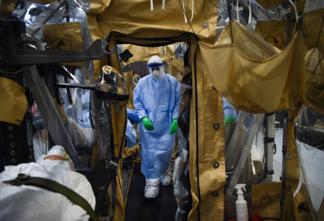 An Airman performs the final set of checks during Transportation Isolation System, or TIS, training while practicing patient care in a containment unit at Joint Base Charleston, S.C., March 5, 2019. Engineered and implemented after the Ebola virus outbreak in 2014, the TIS is an enclosure the Department of Defense can use to safely transport patients with highly contagious diseases. (U.S. Air Force photo by Senior Airman Cody R. Miller)