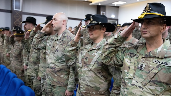 5558f9d6485 ... the National Anthem during a transfer of authority ceremony at the  Joint Training Center